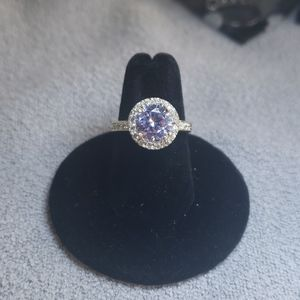 Blue round crystal in pave setting ring